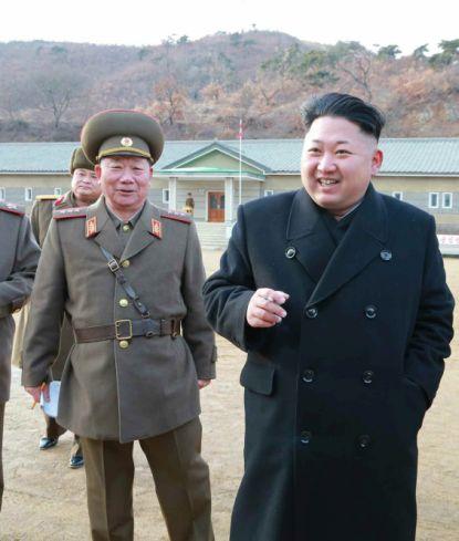 http://worldmeets.us/images/Kim-jong-il-smokes-smiles_pic.jpg