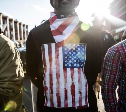http://worldmeets.us/images/baltimore-unrest-man-flag_pic.jpg