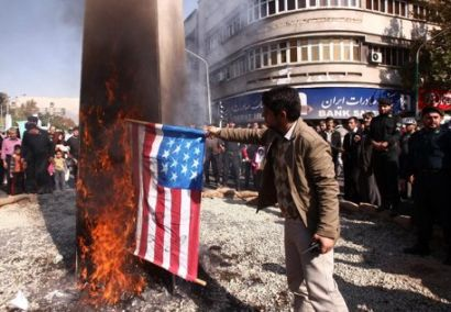 people iran warm huddling burning flags chanting death america