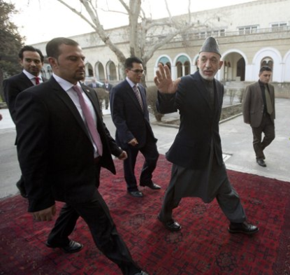 http://www.worldmeets.us/images/karzai-walks_pic.png