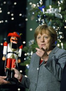 http://worldmeets.us/images/merkel.christmas.toy.text_pic.jpg