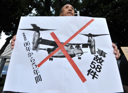 http://www.worldmeets.us/images/okinawa-protester-osprey_pic.png
