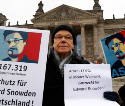 http://worldmeets.us/images/snowden-Reichstag-protestor_pic.jpg